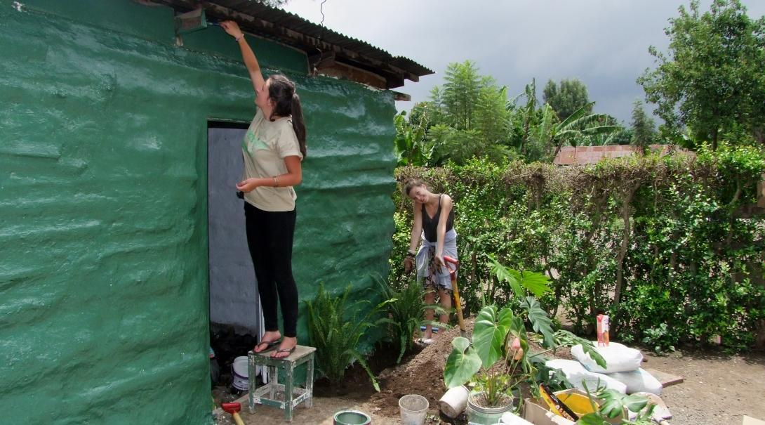 Seen here is a female Projects Abroad volunteer assisting with building a home for a local family during her building volunteer work in Tanzania